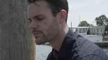 a man alone on a dock