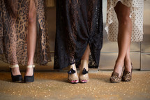 Women's legs, with fancy shoes on their feet.