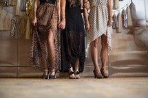 legs of women in high fashion dresses