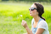 blowing a dandelion