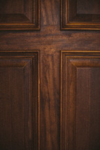 Paneled wooden door.
