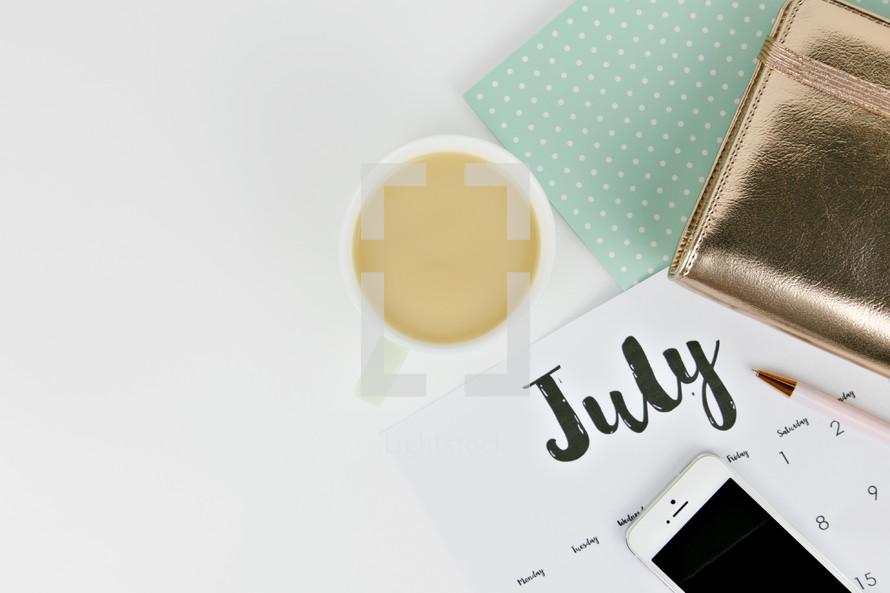planner, calendar, pen, and iPhone