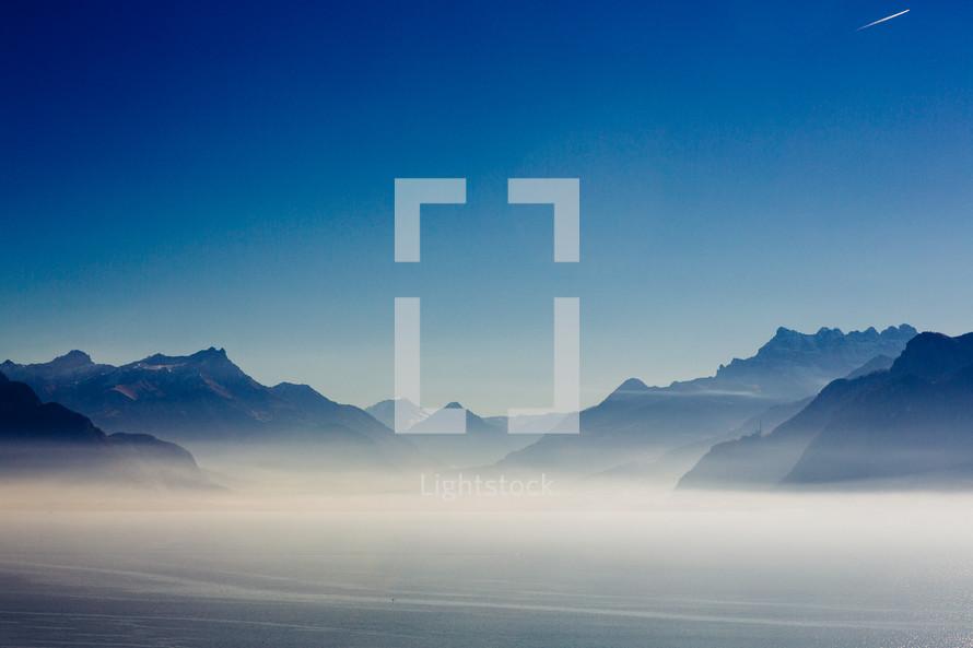 fog around Mountains in Switzerland