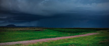 storm clouds over a green plain