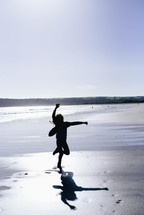 silhouette of a child playing on a beach