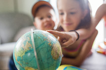 kids playing with a globe
