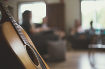 guitar and young adult Bible study group
