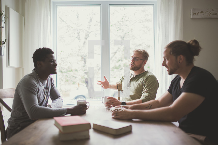 men's group sitting around a table studying the Bible