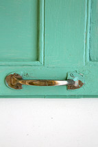 teal door and door pull