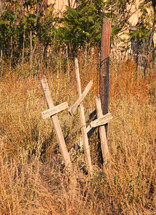 three crosses at the side of a road