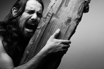 The suffering of Christ -- Jesus crying in pain while as he carries the cross.