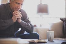 praying praying over a Bible