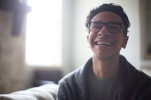 a joyful man in reading glasses
