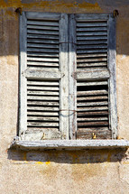 old wood shutters on a window in Italy