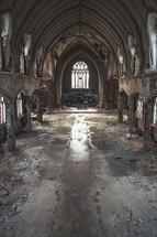 Sanctuary shot of a deteriorating and abandoned church.