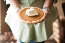 woman with a pumpkin pie
