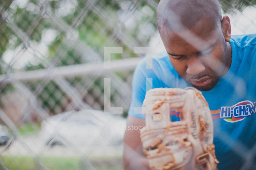 man in prayer in a baseball diamond