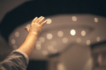 hand raised in praise to God