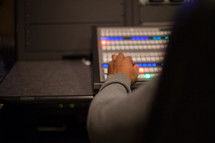 hands on a control panel