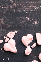 crumbs and pink heart shaped cookies
