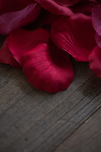 rose petals on wood