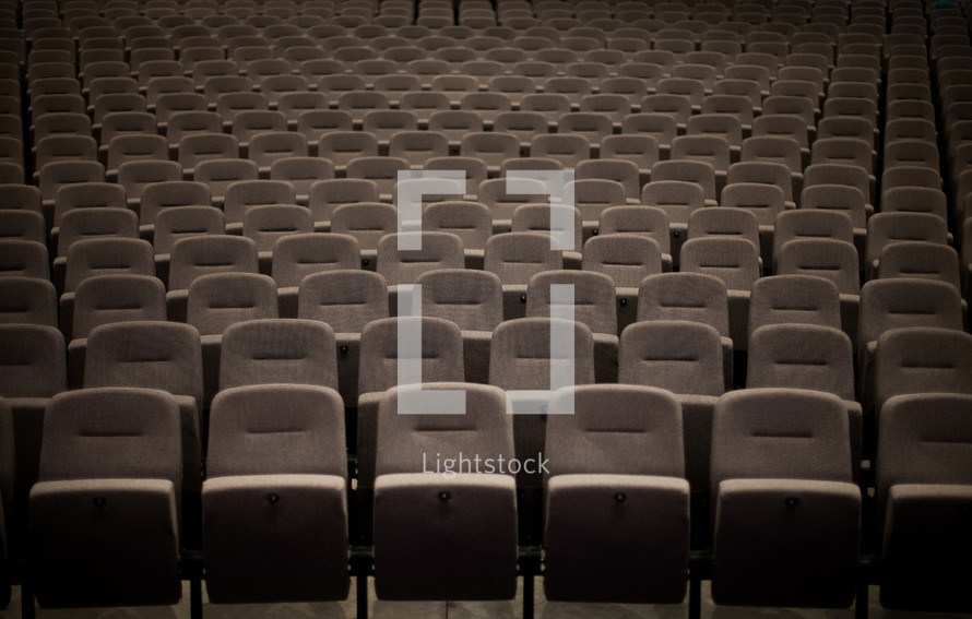 Rows of seats in an empty auditorium.
