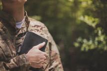 serviceman holding a Bible
