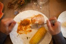 man eating a Thanksgiving dinner