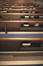 liturgy books in the back of church pews