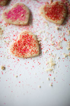 pink and red sprinkles on cookies