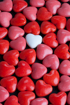single white heart and red heart shaped candy