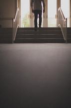 man exiting a church