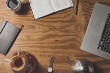 trinkets on a table, journal, Bible, laptop, watch, coffee, tea, pen