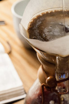Pouring water into a coffee filter.