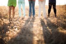 legs of women standing outdoors