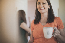 woman holding a coffee mug