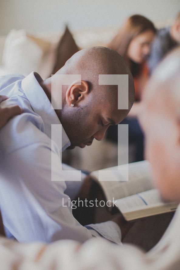 group prayer at a Bible study