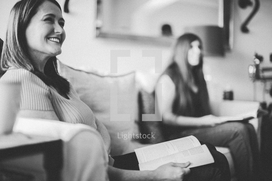 women at a Bible study sitting reading Bibles on a couch