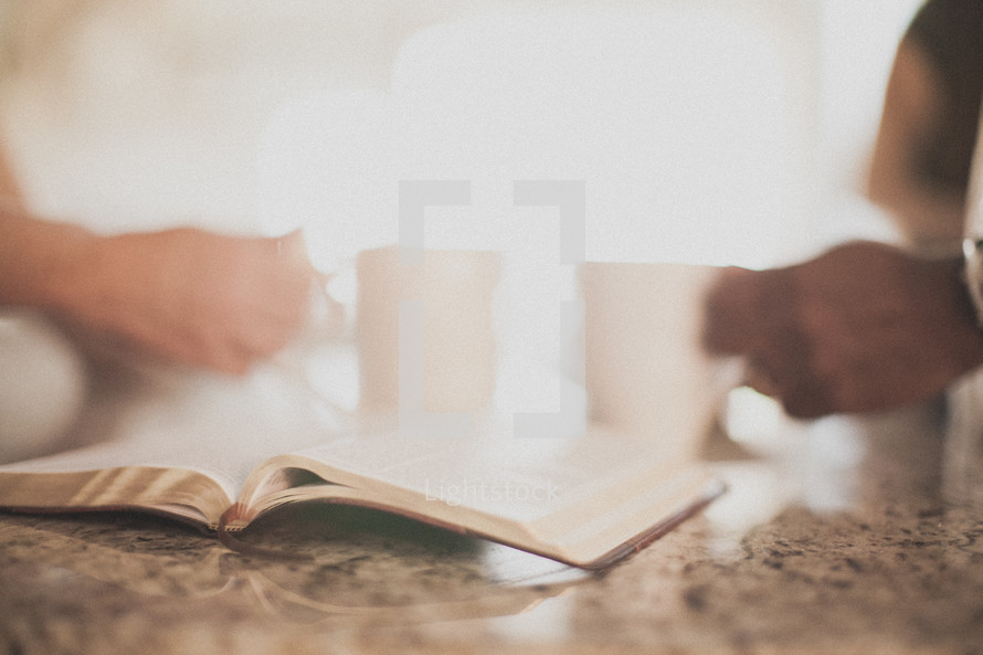 open Bible on a kitchen counter