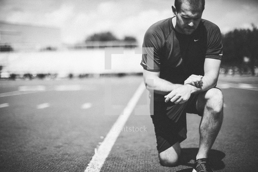 athlete kneeling in prayer