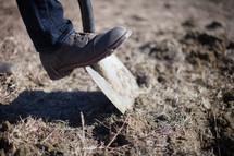 foot on a shovel
