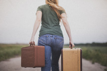 woman carrying suitcases