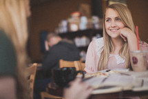 Smiling women at Bible study over coffee.