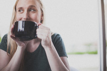 Woman drinking coffee.