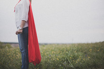 A super hero mom dressed in a red cape