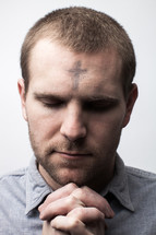 A man with ashes on his forehead for Ash Wednesday