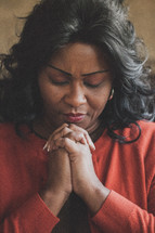 Woman in prayer.