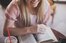 woman reading a a Bible