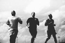 Men running on a track.
