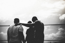 Silhouette of men in a huddle.